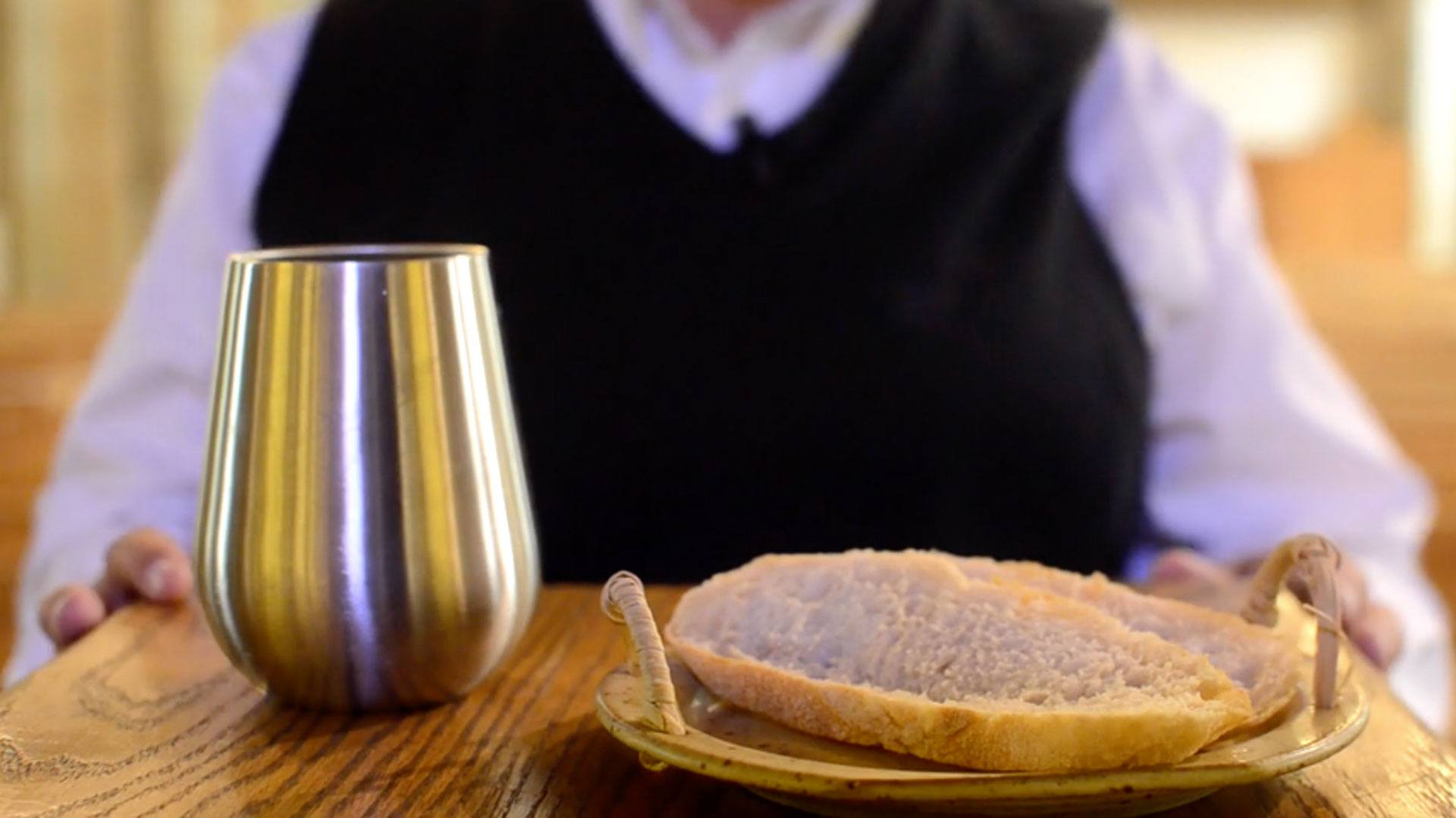 Photo of Terry Smith holding communion elements