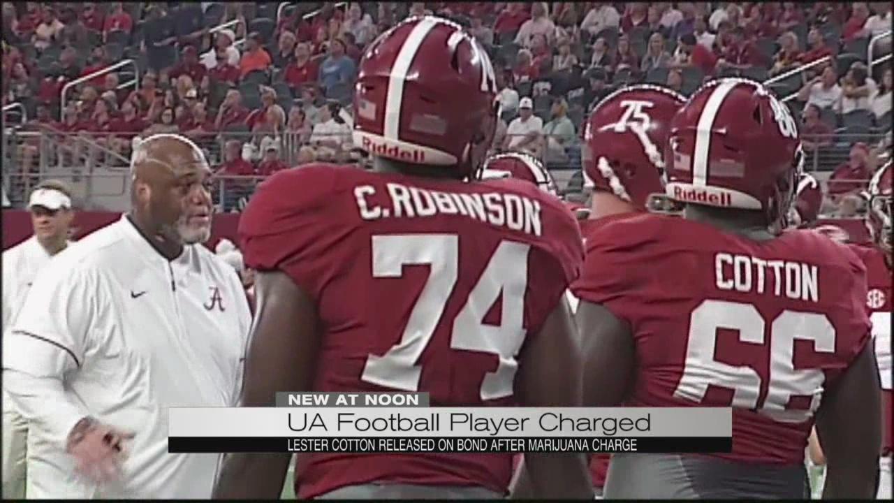 UA football player charged