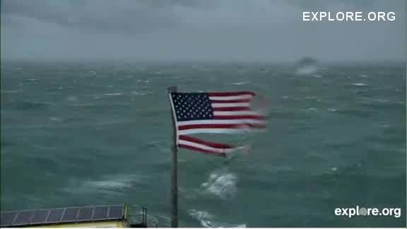 American flag atop Frying Pan Tower in Outer Banks rips from Hurricane Florence's winds