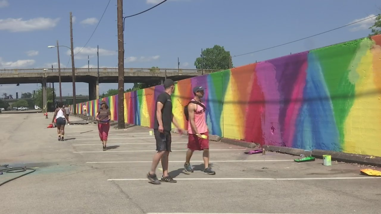 Hundreds help paint the Rainbow Wall in downtown Birmingham