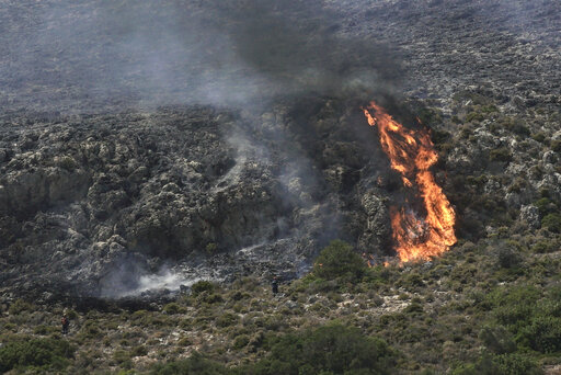 Tourists evacuated from Greek island camp as wildfire rages | WIAT