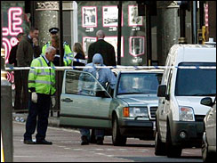 British police forensic officers investigate a vehicle which contains a suspected bomb near Piccadilly Circus in central London, Friday June 29, 2007.