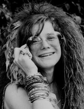 janis joplin holding her sun glasses