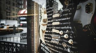 hidden page on a guitar for the decode jay z project with bing