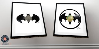 2 batman logos carved from a couple of used vinyl records