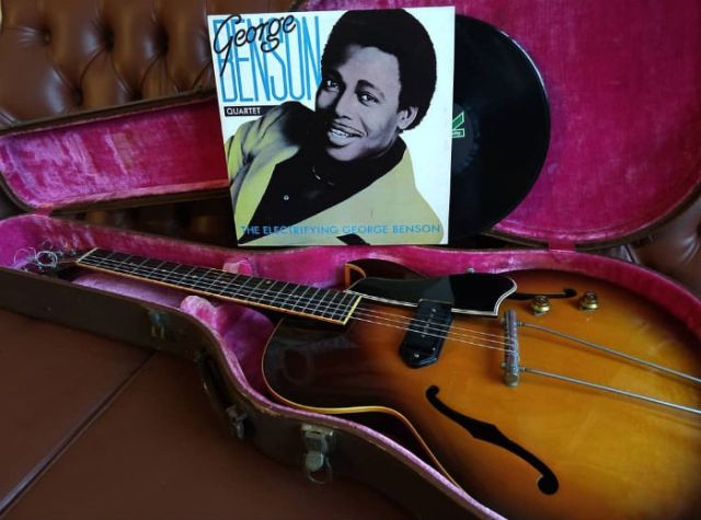 a guitar and a record of george benson