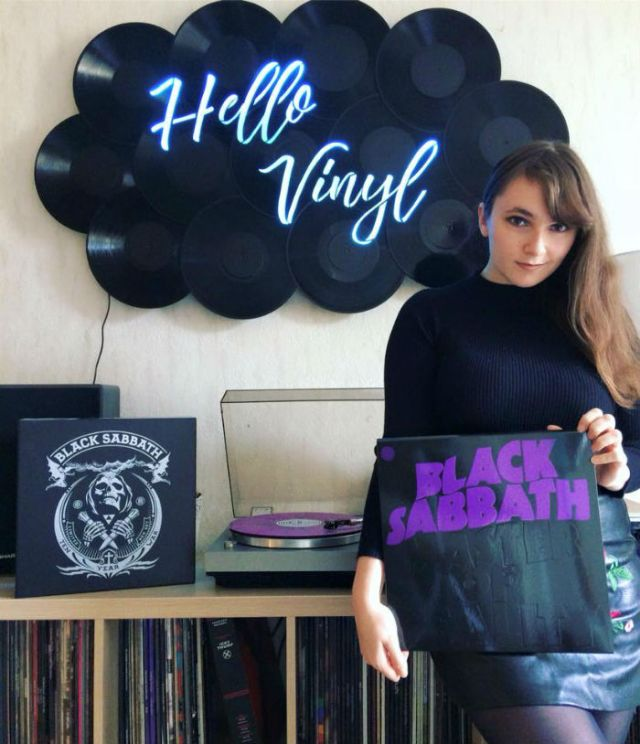 hello vinyl holding a black sabbath album