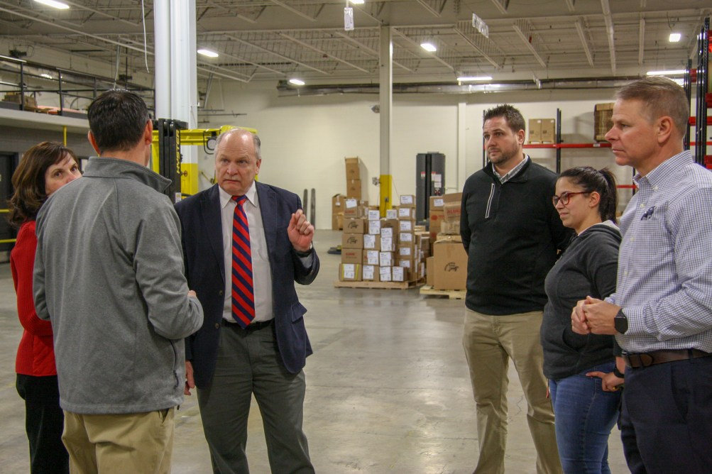 Trevor Stohr, President, discusses our warehousing operations with Mayor Clough.
