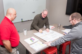 Smaller meeting rooms feature standing tables and glass white boards to encourage cooperation and collaboration.