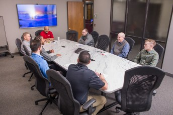 A large conference table, comfortable seating, and advanced communications equipment make meetings enjoyable for those local and remote