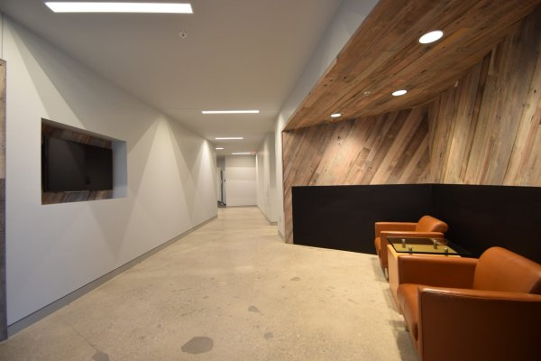 Carhart Headquarters entrance with wood wall and seating