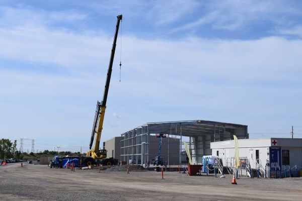 11yellow crane above warehouse metal exterior