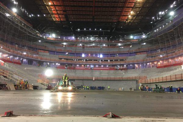 11Little Caesars Arena interior laying down concrete