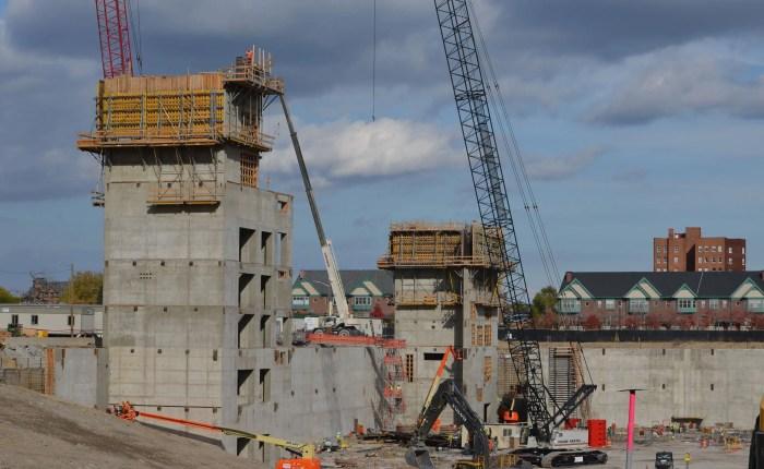 Concrete building exterior with crane