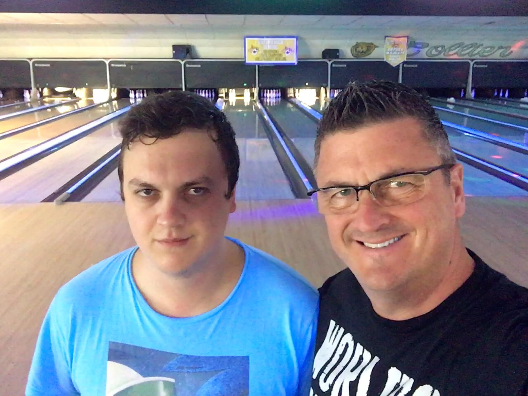 Chris Foster with son at bowling alley