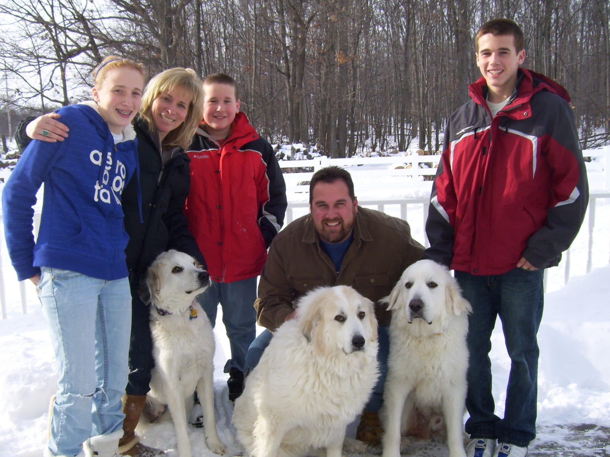Joel Lewandowski with family and dogs