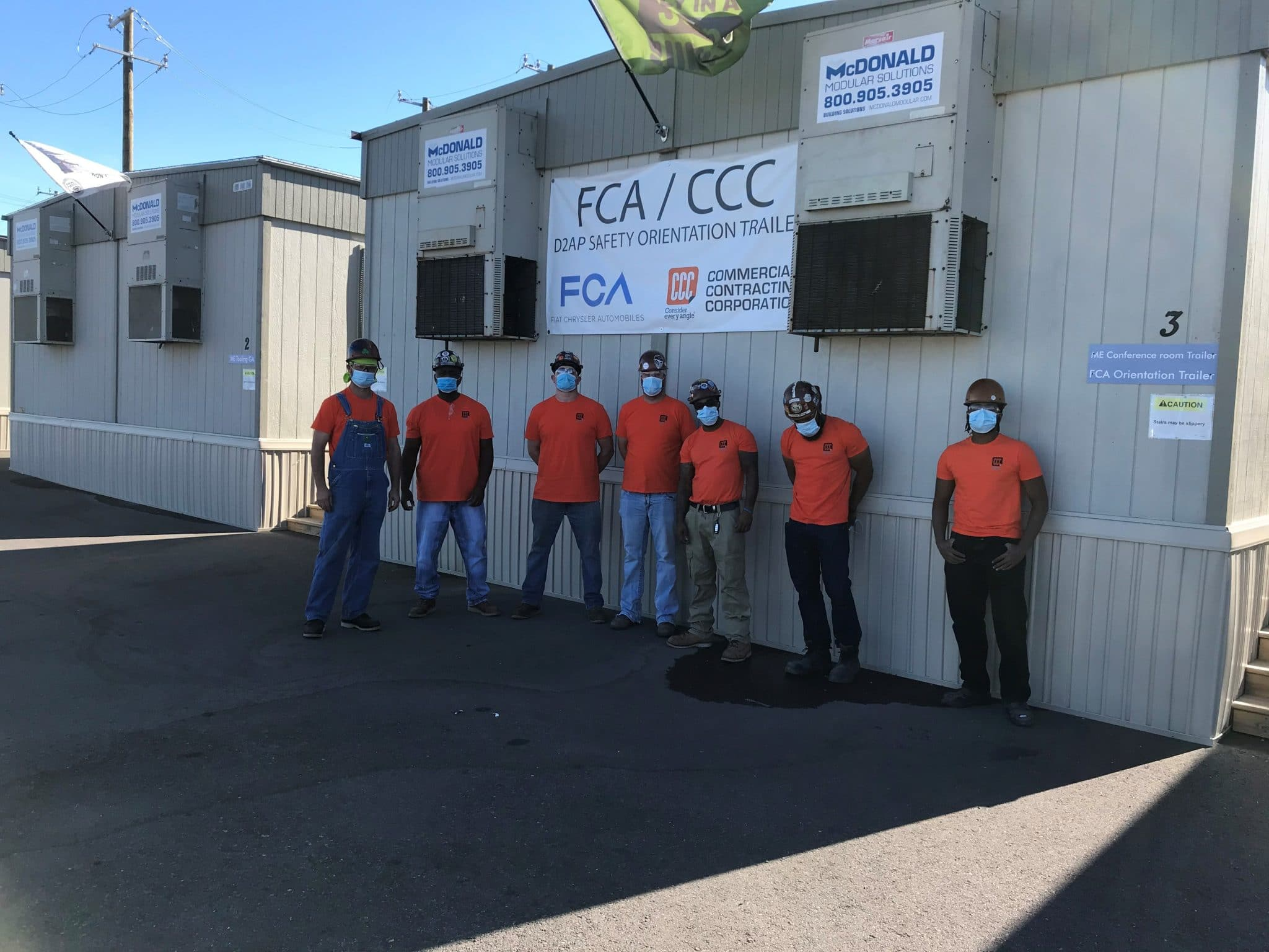 group of workers pose with FCA/CCC sign