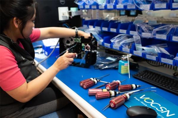 woman in vest builds ventilator