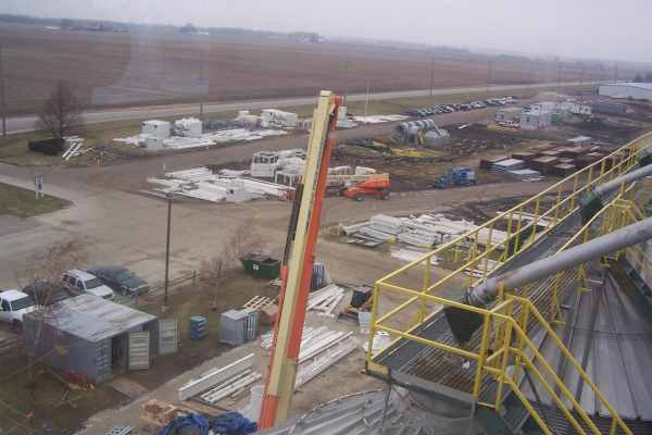 11construction site with building materials on farmland