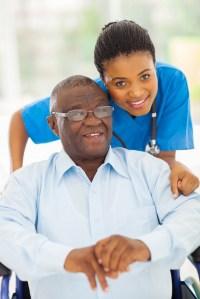 Elderly Man With Caregiver