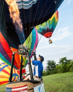 Balloon pilot Matthew McClinton, of SkyCab Balloon Promotions, heats the air inside the AT&T balloon, in preparation for take off in Poughkeepsie, NY. McClinton, 22, of Louisville, KY, mentioned his thanks to AT&T for contributing to the Balloon Festival and giving him the opportunity to fly this balloon. (July 7, 2012) NY. (July 7, 2012)