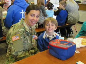 A Student and His mom eating lunch on Veterans Day.