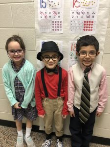 Kindergarten students dressing up for the 100th day
