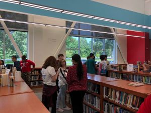 "Groups of students complete library ""missions."""