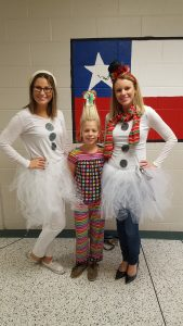 Two teachers with a student dressed like movie characters
