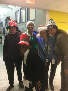 Four teachers with holiday hats