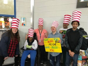 teacher and students with Dr. Seuss hats on