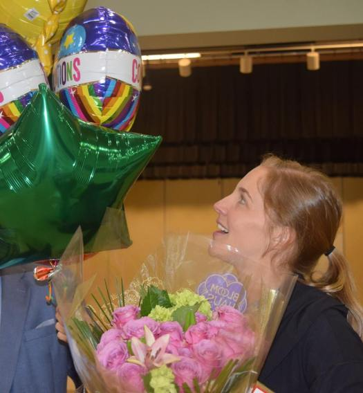 TEACHER RECEIVING FLOWERS AND BALOONS