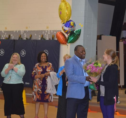 SHELBY RECEIVING FLOWERS FOR TEACHER OF THE YEAR