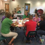 Teachers talking in small group