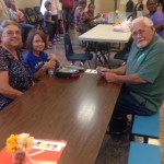 Student eating lunch with grandparents