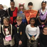 9 students dressed up in costumes