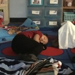 Student sleeping on the carpet