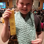 Student posing with winning fiber art