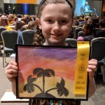 Student posing with winning water color art