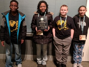 four Students posing with advertising design award