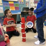 Students showing their Cat in the Hat stack