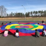 Students holding parachute