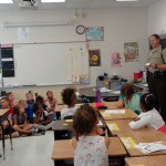 Deputy Hall talking to the 2nd graders