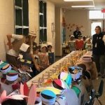 Kindergarten students sitting down to feast