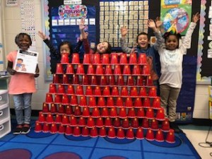 Students with 100 stacked cups