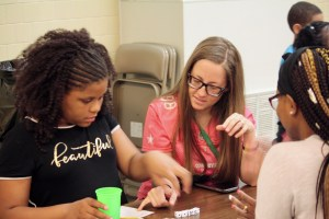 Teacher and student playing Yahtzee