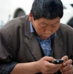 man repairing broken smartphone screen