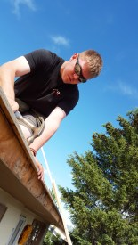 CCR Creative Renovations nailing in a new roof