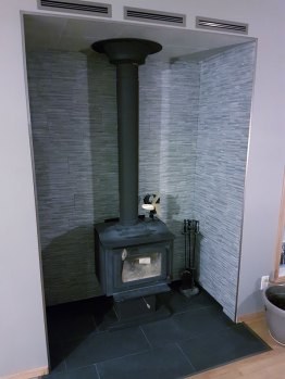 Completed alcove with wood burning stove and renting