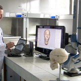 Morphology official examining computer reconstruction.